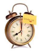 Relógio despertador com adesivo isolado no branco — Fotografia Stock