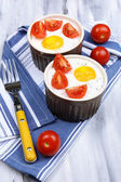 Baked eggs on wooden table close up — Stock Photo