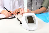 Measuring pressure of patient in hospital close-up — Stock Photo