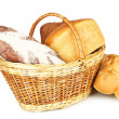 Composition with bread and rolls in wicker basket isolated on white — Stock Photo #40790723