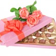 Delicious chocolates in box with flowers isolated on white — Stock Photo #40809259