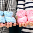 Hands with crocheted booties for baby, close-up — Stock Photo #40814341
