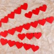 Stock Photo: Paper hearts on paper background
