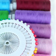 Stock Photo: Colored spools of threads close up