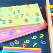 Colorful numbers, abacus, books and markers on school desk background — Stock Photo