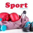 Stock Photo: Sports bag with sports equipment isolated on white