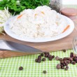 Composition with fresh and marinated cabbage (sauerkraut), spices, on color napkin background — Stock Photo