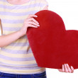 Female holding big red heart isolated on white — Stock Photo #40819535