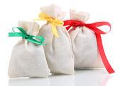 Textile sachet bags isolated on white — Stock Photo