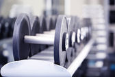 Lot of dumbbells in gym close-up — Stock Photo