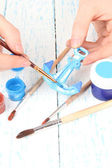 Hands paints on hand made ceramic anchor and art materials — Foto Stock