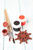 Hand made ceramic wheel and color paints on wooden table — Stockfoto