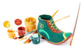 Hand made ceramic saint patricks day boot and color paints isolated on white — Stock Photo