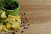 Parmesan cheese, fresh herbs and olives on wooden background — Stock Photo