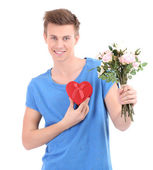 Portrait of handsome young man with flowers and gift, isolated on white — Stock Photo