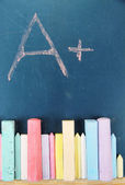 Education rating and colorful chalks on school desk — Foto Stock