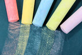 Colorful chalks on school desk — Stock Photo