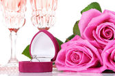 Composition with pink sparkle wine in glasses, and pink roses isolated on white — Stock fotografie