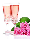 Composition with pink sparkle wine in glasses and pink roses isolated on white — Foto Stock