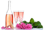 Composition with pink sparkle wine in glasses, bottle and pink roses isolated on white — Foto de Stock