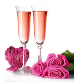 Composition with pink sparkle wine in glasses, and pink roses isolated on white — Stock Photo