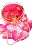 Composition with pink sparkle wine in glass and rose petals isolated on white — Stockfoto