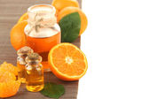 Tangerine essential oil and tangerines, isolated on white — Stock Photo