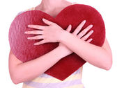 Female holding big red heart isolated on white — Stockfoto