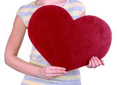 Female holding big red heart isolated on white — Stock Photo