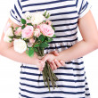 Beautiful little girl with flowers in her hand, isolated on white — Stock Photo #40820141
