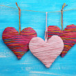 Decorative hearts on wooden background — Stock Photo #40820385