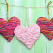 Decorative hearts on wooden background — Stock Photo #40820407