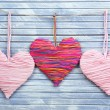 Decorative hearts on wooden background — Stock Photo #40820449