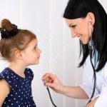 Little girl at doctor — Stock Photo