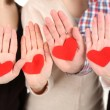 Stock Photo: Hands with hearts, close up