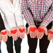 Stock Photo: Hands with hearts, isolated on white