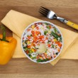 Cooked rice with vegetables on wooden table — Stock Photo #40826017
