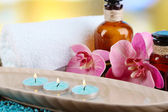 Beautiful spa setting with flower on bright background — Stock Photo