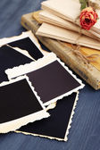 Blank old photos, photo album and dried flower, on color wooden background — Stock Photo