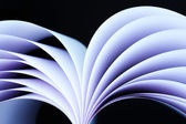 Abstract image of sheets white paper wave shape on black background close-up — Stock Photo