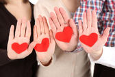 Hands with hearts, close up — Stock Photo