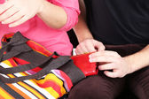 Pickpocket are stealing wallet from bag, close up — Stock Photo