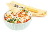 Cooked rice with vegetables isolated on white — Stock Photo