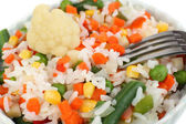 Cooked rice with vegetables close up — Stock Photo