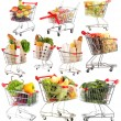 Trolleys with different products isolated on white — Stock Photo #40848251