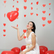 Attractive young woman with balloons in room on Valentine Day — Stock Photo #40848625