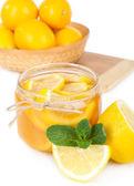 Tasty lemon jam isolated on white — Stock Photo