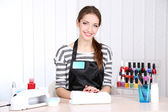 Beautiful girl manicurist in beauty salon — Stock Photo