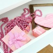Stock Photo: Gift box and beads in open desk drawer close up