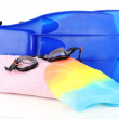 Stock Photo: Pool cap, goggles, flippers and towel isolated on white